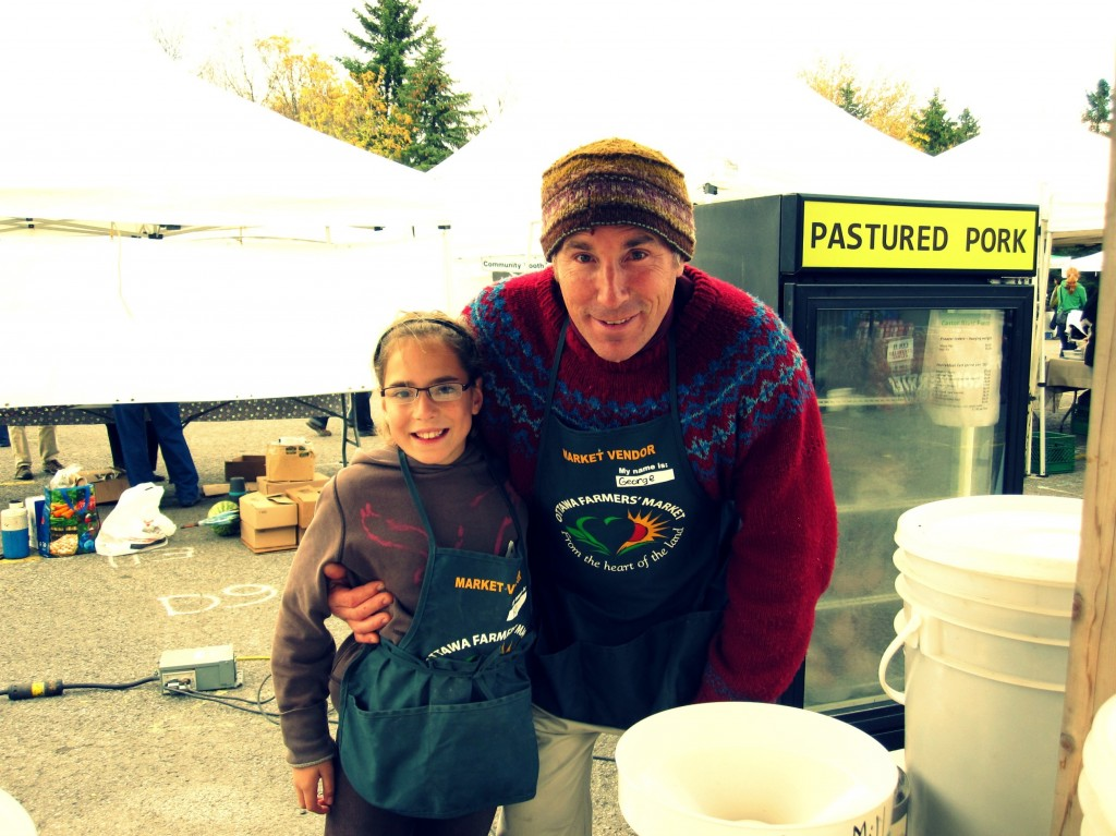George Wright from Castor River Farm bundling up for a chilly day at the Market.