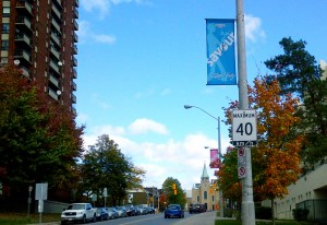 Gladstone Avenue at Preston Street is a pleasant residential area, lined with trees and banners