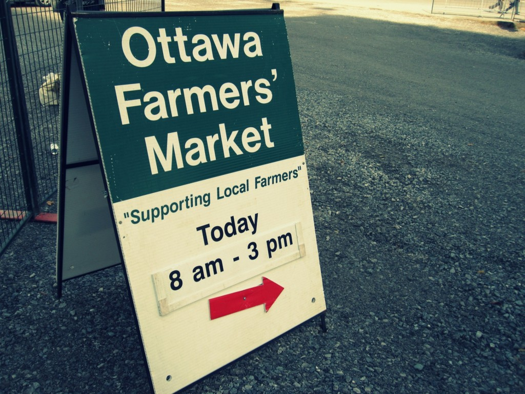 Ottawa Farmers' Market Sign sitting outside of Lansdowne Park to attract visitors.
