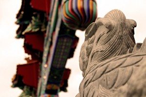 One of the stone lion statues guards the Ottawa Chinatown archway