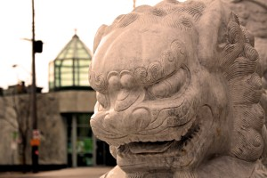 One of the Chinatown stone lion statues